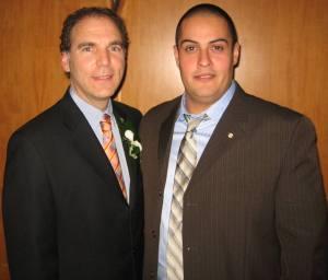 Glenn J. Nashen congratulating Public Security Officer Hugo Perez