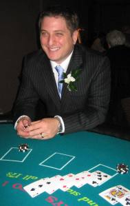 Public Safety Director Jordy Reichson takes a risk at the black jack table