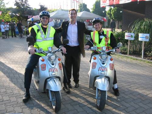 Mayor Anthony Housefather and the volunteer Citizens on Patrol Electric Scooter Brigade, Elaine and Abe