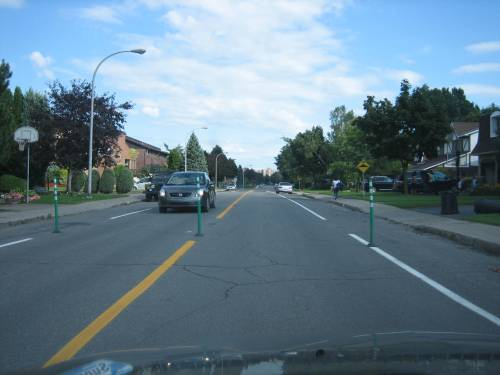 Street line markings and bollards narrow the width of Einstein Avenue resulting in slower traffic patterns