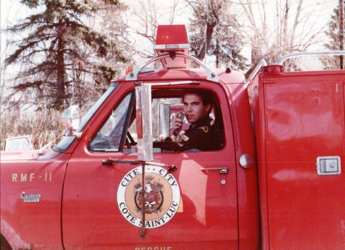 Glenn J. Nashen riding aboard Cote Saint-Luc's first Rescue Medical Fire vehicle RMF-11, 1981