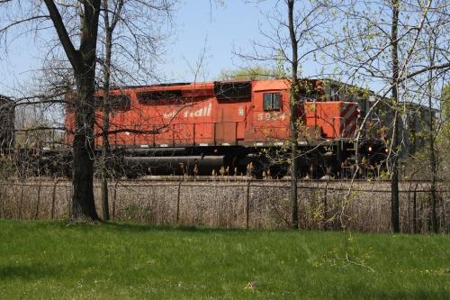 CP Rail locomotive passes Richard Schwartz Park on Cote Saint-Luc Road and prepares to enter the St. Luc Yards