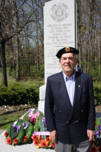 George Nashen in front of the Cote Saint-Luc cenotaph in Veterans Park on VE Day 2012