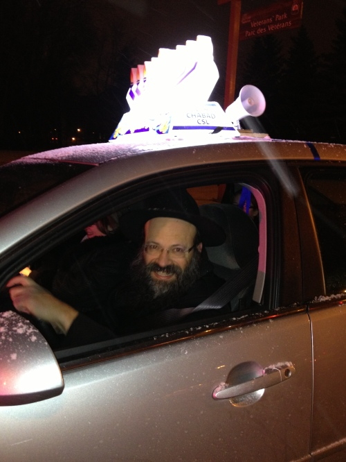 Rabbi Raskin in the lead car for the Chanukah parade