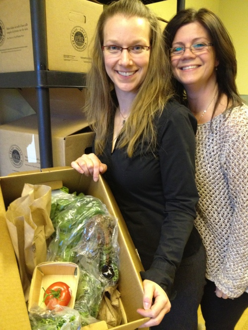 Tanya Abramovitch and Tammy McEwen with a healthy box of biologic grown vegetables