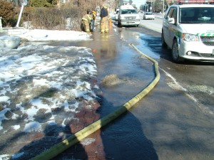 Crews work to shut of valve to the water pipe on Kildare Road