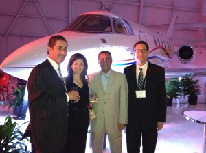 Councillor Mitchell and Elaine Brownstein with Neil Drabkin and Councillor Herbert Brownstein in the hangar at Starlink Aircraft