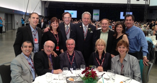 Representatives from Cote Saint-Luc, Hampstead and Montreal welcome the new FCM president, Lachine Borough Mayor Claude Dauphin (standing centre)