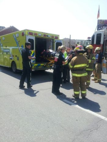 Patient is loaded onto ambulance after being hit by a bus at Kildare Road and Cavendish Blvd.