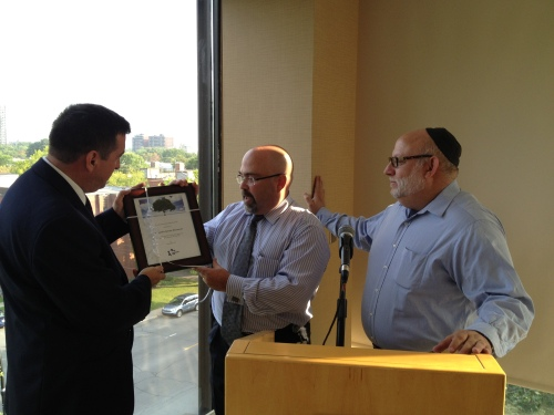 Rabbi Reuben Poupko and Moshe Ben shach present a plaque to Commander Sylvain Bissonnette