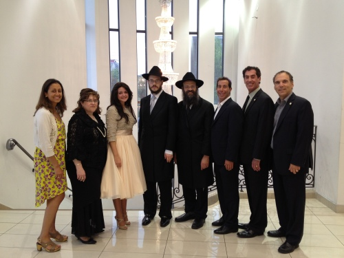 L-R: Dr. Judy Hagshi, proud mother Sarah Raskin, Mushkee and Yankel Raskin, beaming Rabbi Mendel Raskin, Mayor Anthony Housefather, Councillor Mitchell Brownstein and Glenn J. Nashen
