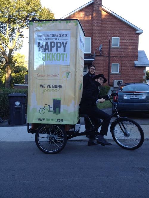 Photo of the week: Three-wheeling Sukkah in Hampstead
