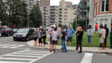 Onlookers heald back by police lines on Baily Road (Photo: CBC News)