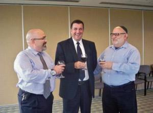 Outgoing Station 9 commander Sylvain Bissonnette, centre, is toasted by Moshe Ben-Shach, left, and Rabbi Reuben Poupko