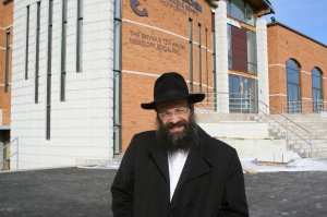 Rabbi Mendel Raskin in front of the new, sprawling Hechel Menachem Beth Chabad of Cote Saint-Luc (Photo: Mike Cohen)