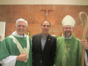 St. Richard's Parish 50th anniversary mass of thanksgiving and installation of Father Peter Laviolette (left) by  Bishop Thomas Dowd (right)