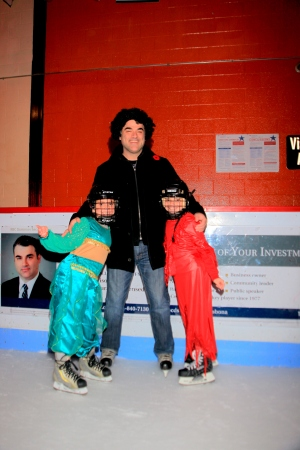 David Lisbona gets into the spooky spirit with his kids. Notice his clean cut image on the rink board ad.