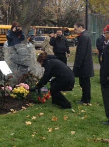 CSL Cllr. Ruth Kovac lays a wreath at the Hampstead cenotaph as Cllr. Glenn J. Nashen looks on