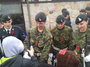 Members of the Royal Canadian Legion Branch 14 talking with the school children