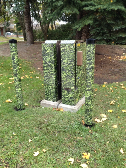 Nature-like decals camouflage utility boxes