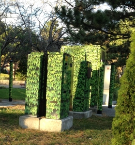 Bell boxes along Guelph Road in Yitzhak Rabin Park camouflaged with greenery