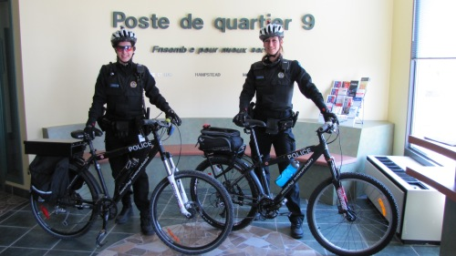 Police officers Elyanne Caouette and Josée Bergeron suited up for two-wheeled patrol