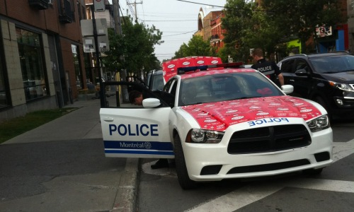 Montreal police car covered in union protest stickers