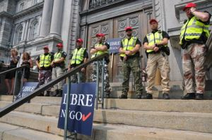 Montreal police dressed in militia gear blocking city hall doors (Source: Sun Media)