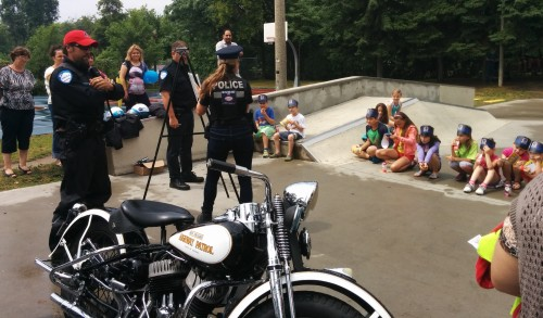 Police officer Marie-Chistine Norbert teaching neighbourhood kids to be safe