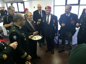 Hampstead Mayor William Steinberg toasts Remembrance Day organizer Mike Fitzpatrick and members of RMR