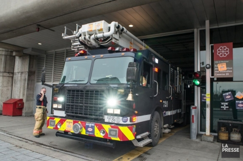 Montreal firefighters painted trucks black to protest government claw back on pension
