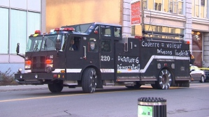 Montreal firefighters have painted 150 of the city's 200 trucks in black watercolour paint. (Photo: CBC News)