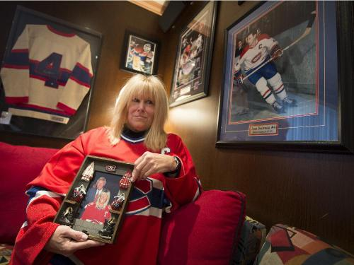 Cheryl Nashen in her den with Jean Béliveau hockey memorabilia. Nashen invited Béliveau to her wedding years ago and also to her daughter's first birthday party. He couldn't make either, but sent hand-written notes, which she kept. (Peter McCabe / Montreal Gazette)