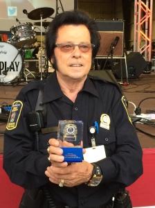 "35 year veteran of CSL, Public Security Agent Jean-Noel ""Elvis"" Champagne, accepts his encased badge upon his retirement"