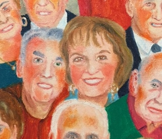 My parents, Phyllis and George Nashen, among 185 smiling seniors on canvas