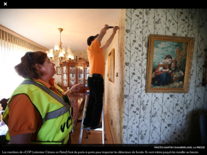 vCOP Smoke Detector Brigade goes door to door inspecting mandatory smoke detectors and will go so far as to install a new one (Photo: Martin Chamberland, La Presse)