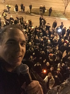 High above the crowd, Acting Mayor Glenn J. Nashen prepares to light the giant Chanukah Menorah and sing the prayers