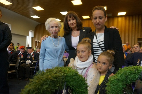 Four generations: Survivor Ilse Zilversmith, Cllr. Ruth Kovac, Debbie Kovac and Nicole and Danielle Jutras lay a memorial wreath for victims of the Holocaust