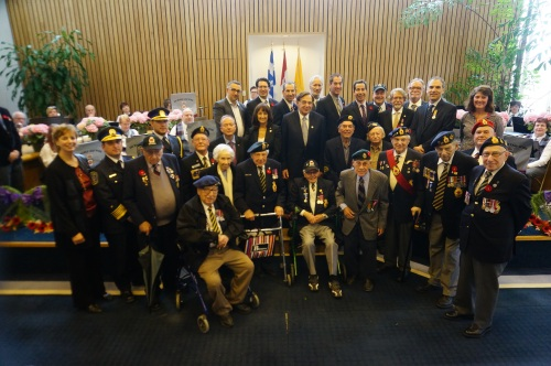 Veterans of WWII are joined by municipal, provincial and federal representatives along with consuls of the US, the Netherlands and Israel