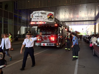 Winnipeg Fire Chief John Lane leads his service in the Pride parade