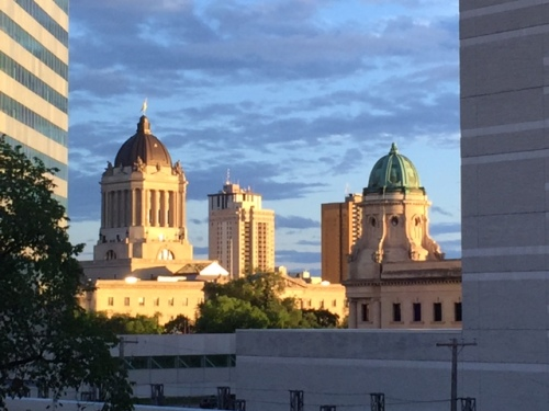 The Manitoba Legislature with the Golden Boy atop and the Manitoba Law Courts with its green dome as photographed from the RBC Convention Centre