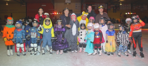 Mayor Mitchell Brownstein and Councillors Allan J. Levine and Glenn J. Nashen with the award winners for best costumes at the CSL Halloween Skating Party