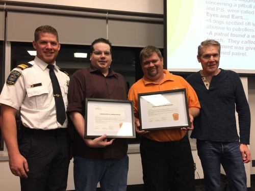 Jeff Smith and Robert McDuff are presented with a special recognition by Public Safety Chief Philip Chateauvert and Supervisor Mitchell Herf on Oct. 5, 2016